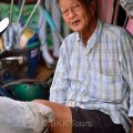 A tricycle rider taking a break at the Railway market in Samut Songkram