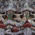Demons supporting the stupa decorated with pieces of Chinese porcelain at Wat Arun, the Temple of Dawn