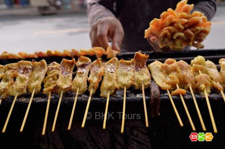 Satay, Thai style spice-marinated barbecued pork on skewers usually sold in bunches